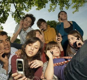 Teens using cell phones